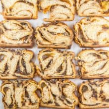 Pumpkin Chocolate Chip Babka: Filled with pumpkin puree, pumpkin pie spices, and chocolate chips and covered with a chocolate chip streusel, this pumpkin chocolate chip babka is a fall take on everyone's favorite chocolate babka. #bunsenburnerbakery #bread #yeastbread #babka #chocolatebabka #pumpkinbread #pumpkinchocolatechip