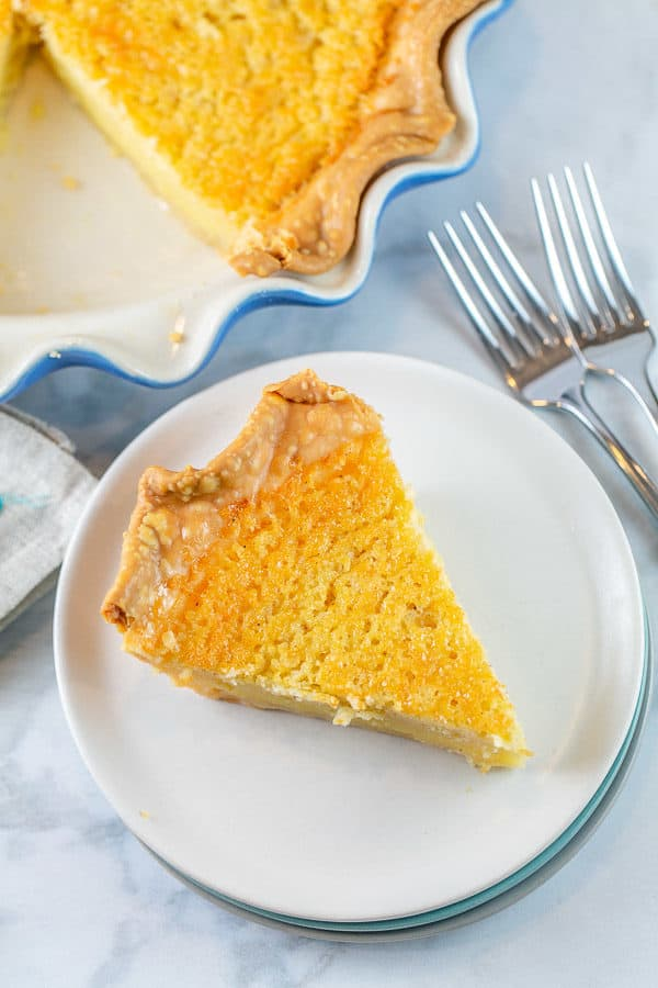 a slice of buttermilk pie on a white dessert plate