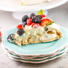 BerryPavlova with Lemon Curd Cream: This classic pavlova recipe is the perfect entertaining dessert. Fancy enough for a dinner party, but extremely easy to make and everything can be made ahead of time! #bunsenburnerbakery #pavlova #berries #lemon #lemoncurd