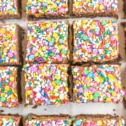Frosted Sprinkle Brownies: These easy homemade fudgy and chewy brownies are better than boxed mix, but just as easy!  And the best part?  The rich and creamy chocolate frosting and colorful sprinkles!  Loved by kids and adults alike! #bunsenburnerbakery #brownies #frosting #chocolate #sprinkles