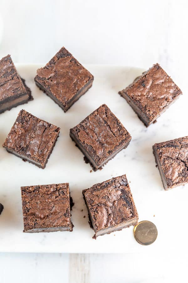 squares of nutella brownies cut and arranged on a marble serving board