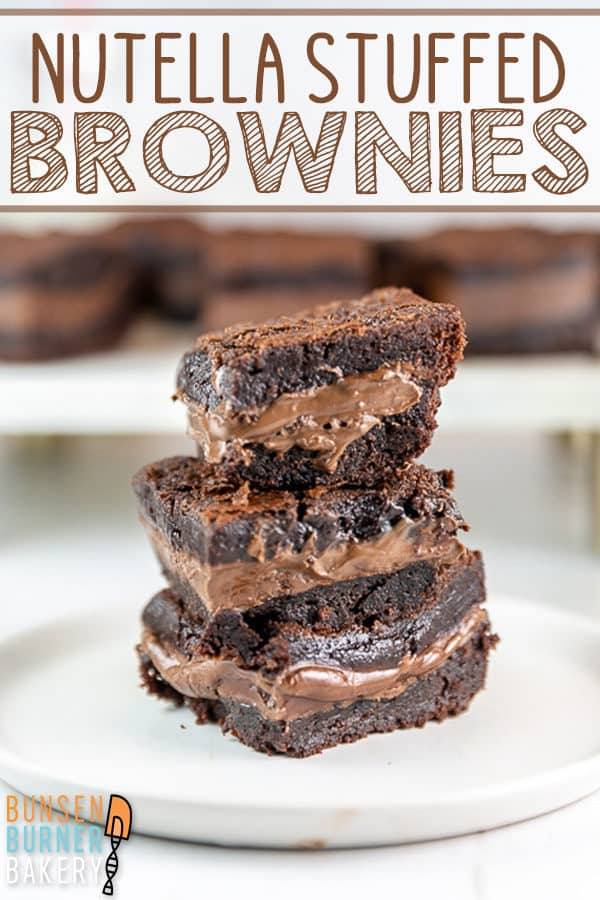 Ultimate Nutella Brownies: Take your brownies up a level with a layer of gooey Nutella baked right inside! With Nutella mixed in the batter and sandwiched in the middle, these easy made from scratch brownies are truly the best! #bunsenburnerbakery #brownies #nutella #nutellabrownies