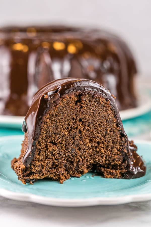 a slice of chocolate pound cake covered with chocolate ganache