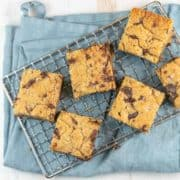 Chocolate Chip Tahini Blondies: Easy to make and unexpectedly delicious, these salted chocolate chunk tahini blondies will be your new favorite (dairy free!) treat. A little gooey and chewy, it's like the grown up version of a peanut butter cookie bar. #bunsenburnerbakery #blondies #tahini #tahiniblondies
