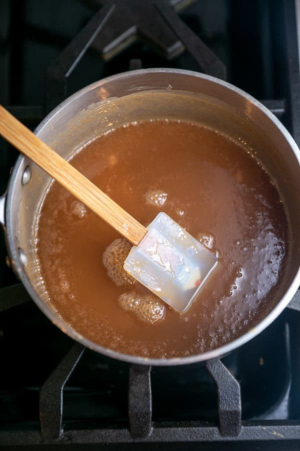 a saucepan full of thick caramel sauce
