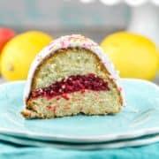 Pink Lemonade Bundt Cake: The BEST lemon bundt cake (an easy from scratch recipe!) with a surprise pink lemonade swirl - strawberry, raspberry, or plain pink lemonade! Perfect for spring and summer birthdays and celebrations. #bunsenburnerbakery #cake #bundtcake #pinklemonade
