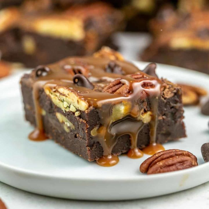 caramel pecan brownie dripping with salted caramel sauce