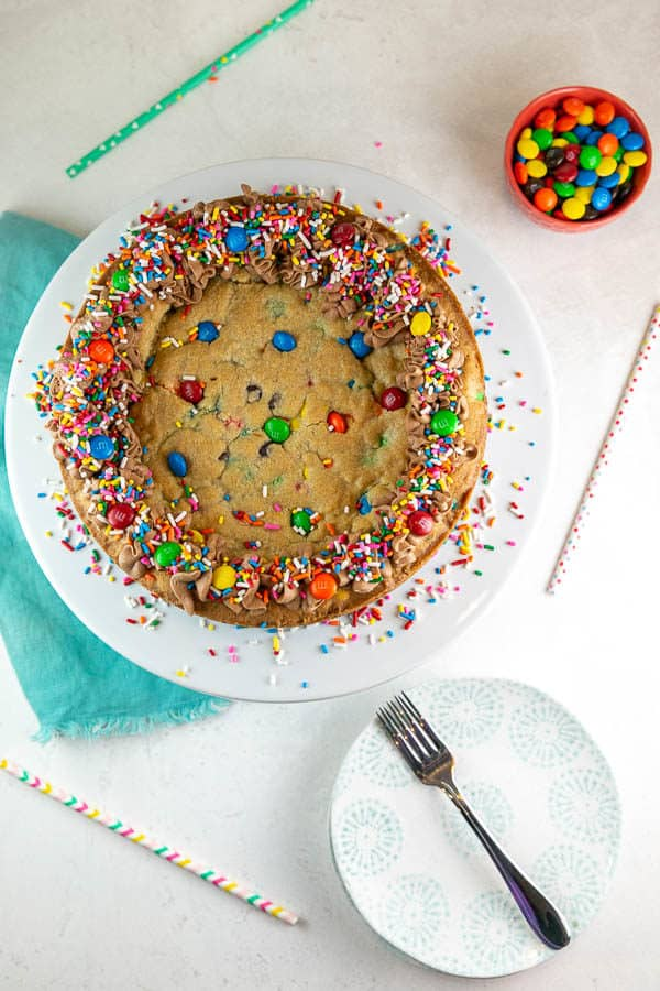 overhead view of the baked and decorated cookie cake