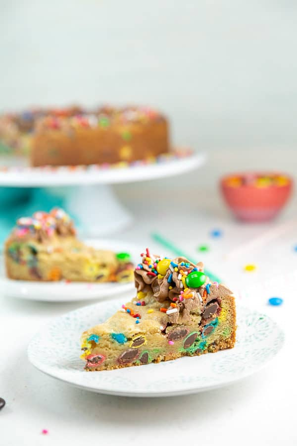 a slice of m&m cookie cake on a small dessert plate
