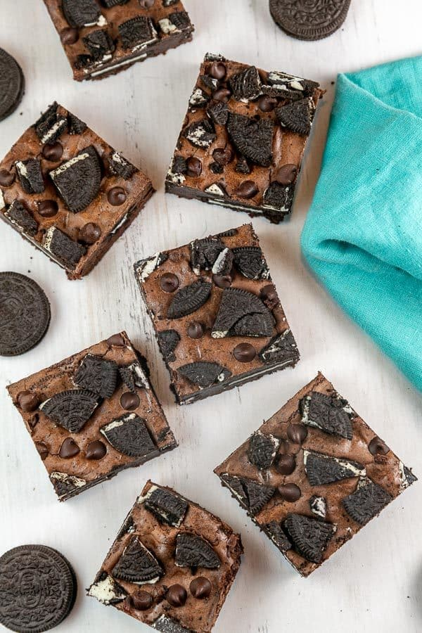 large squares of fudgy brownies with chopped oreos on top