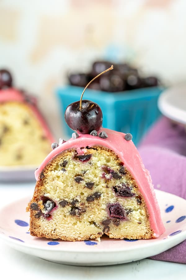 slice of pound cake filled with cherries and chocolate chips