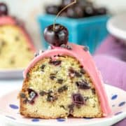 Chocolate Chip Cherry Pound Cake: an easy, moist vanilla almond pound cake filled with chopped cherries (fresh, frozen, or maraschino) and chocolate chips, topped with a cherry fudge frosting. Make in a bundt pan or loaf pan. #bunsenburnerbakery #poundcake #bundtcake #cherries #chocolatecherry