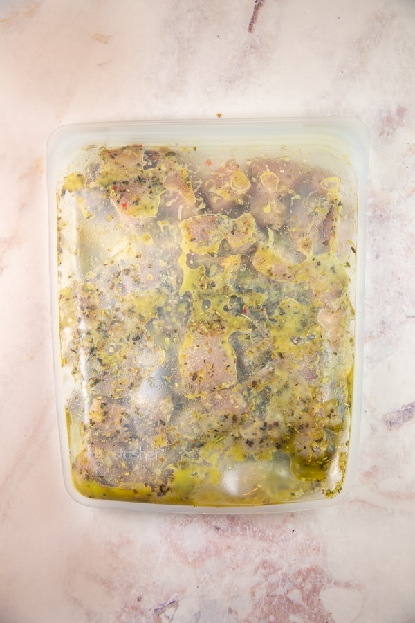 chicken marinating in a reusable freezer bag