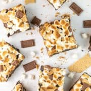 smores brownies surrounded by chocolate and graham crackers