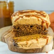 loaf of pumpkin bread with pumpkin buttercream frosting and salted caramel drizzle