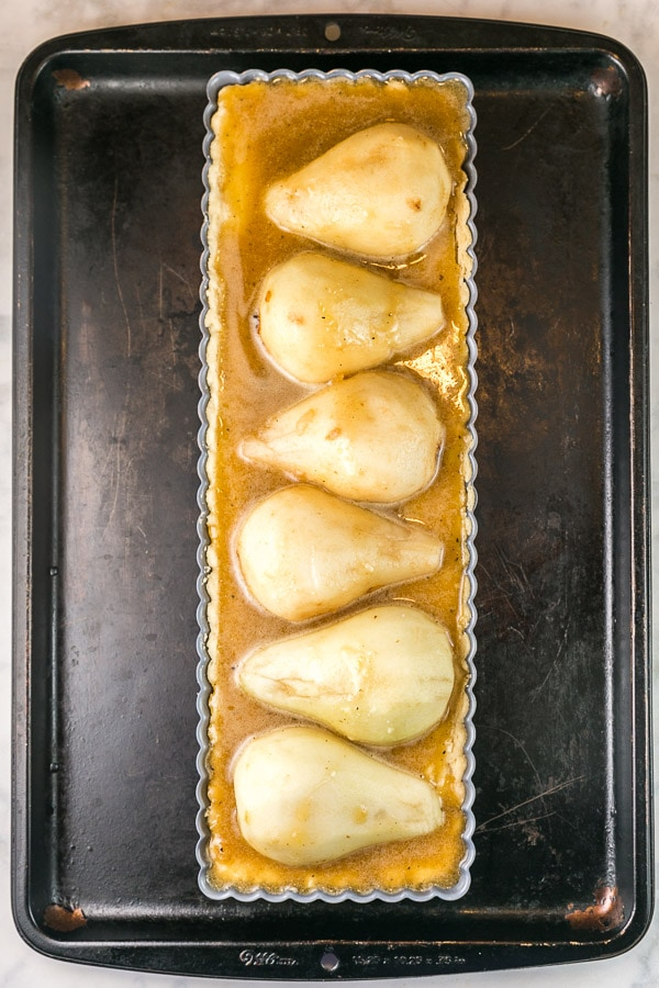 unbaked pear tart with brown butter custard