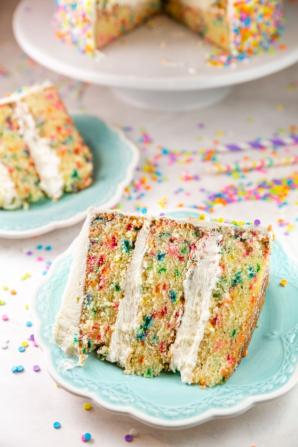 two big slices of funfetti cake surrounded by sprinkles
