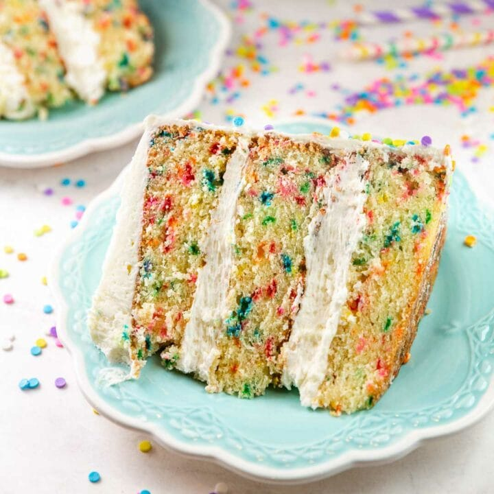 slice of three layer homemade funfetti cake