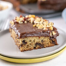 slice of banana chocolate chip cake with nutella frosting and chopped hazelnuts