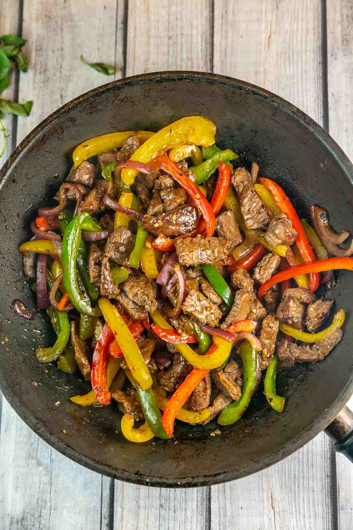 stir fried beef and peppers in a large wok