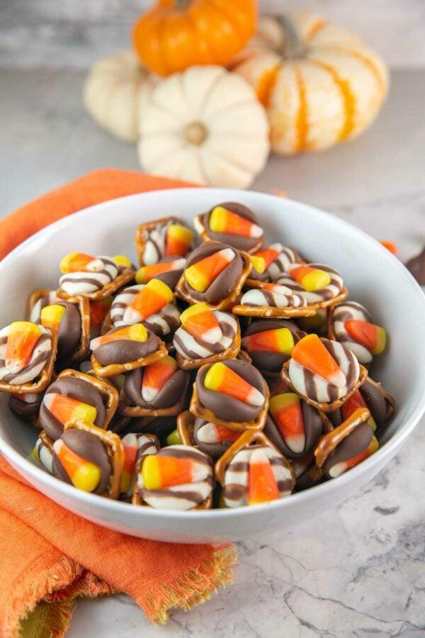 Halloween candy corn kiss pretzel bites in a white bowl