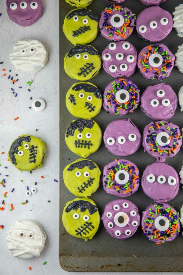 oreo cookies decorated to look like Frankenstein and purple monsters