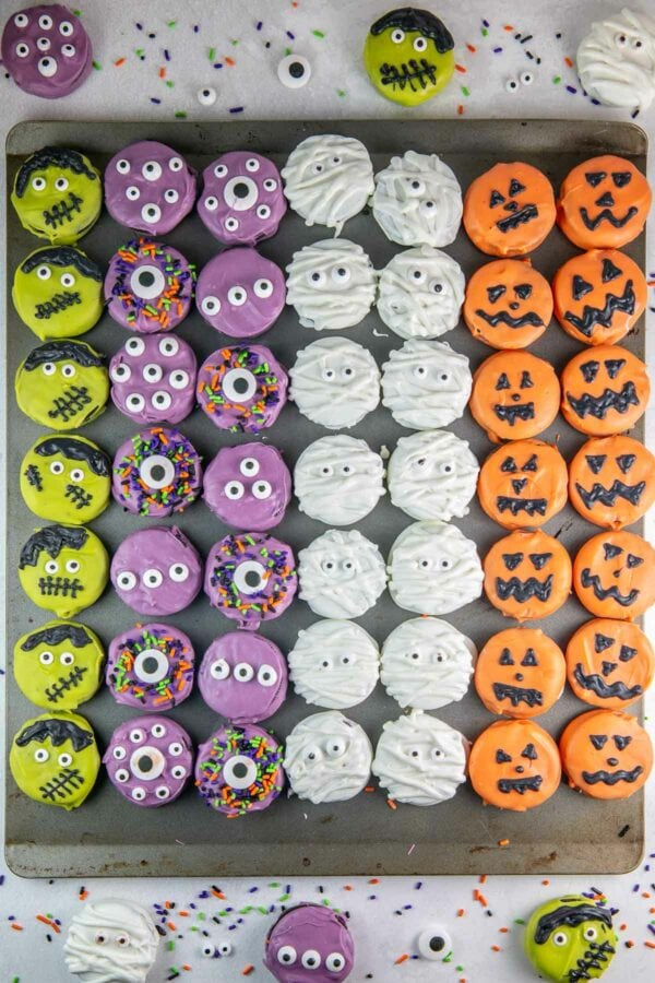 chocolate covered oreos decorated as monsters, mummies, pumpkins, and frankensteins