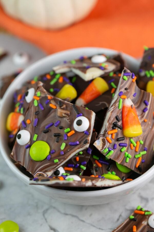 broken pieces of chocolate bark turned into boo bark with Halloween toppings